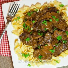 This recipe for Slow Cooker Beef Stroganoff is by far one of the best beef stroganoff recipes I've ever made. Fork tender beef with a rich savoury gravy!