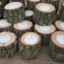 Tree branches as tea light holders - drill press and spade bit needed.