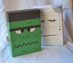 Save your cereal boxes and make Frankenstein and the mummy  cereal box crafts - What You Need  •2 cereal boxes  •construction paper: green, white and black  •2 cardboard egg cups  •black marker  •brown crayon  •white and silver acrylic craft paint  •paintbrush or pencil with eraser  •scissors  •white craft glue  •hot glue gun  •2 zipper sandwich bags filled with sand or pebbles (optional)