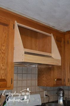 Rather than wasting the space, learn how we used the existing ducting and cabinet above our stove to create a custom DIY storage range hood cover. Kitchen Redo, Kitchen Remodel, Kitchen Design, Kitchen Ideas, Kitchen Updates, Kitchen Makeovers, Kitchen Cabinets, Range Hood Cover, Range Hoods