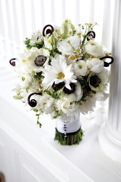Too many flower ideas!!!  Bouquet of standard daisies, feverfew, ranunculus, freesia, lisianthus, anemones, sweet peas and fern shoots, wrapped with a satin ribbon, by Marah Cole Designs in St. Paul. #wedding... I like the daisies, ranunculus, ferns. Maybe some blue in there?