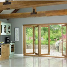 Vu-Fold Folding Patio Doors - These sliding glass doors are unique because they slide and fold. For someone who doesn't want doors to always...