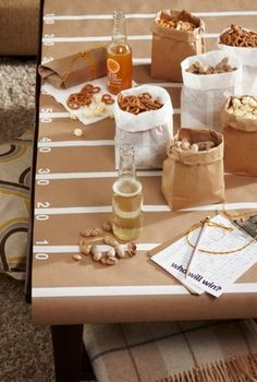 Paper bags as party food bowls, brilliant!