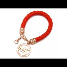 Michael Kors charm Orange leather woven bracelet Up for purchase is one bracelet as shown in the picture. Has a few adjustable links 18 karat gold plated genuine leather unisex, can be a bracelet anklet a purse charm, hair jewelry and some people have decorated their rearview mirror with it. So here you have a multi use item! BNWOT Jewelry Bracelets