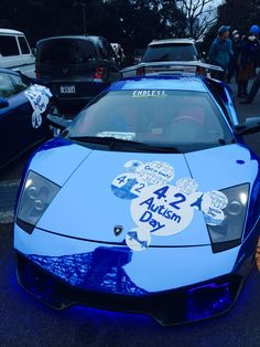 blue Lamborghini with tokyo tower