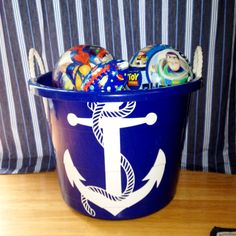 My latest DIY storage for my son's nautical nursery. Bin from Walmart: $4 Decal from Etsy: $6  Also great for a themed playroom!