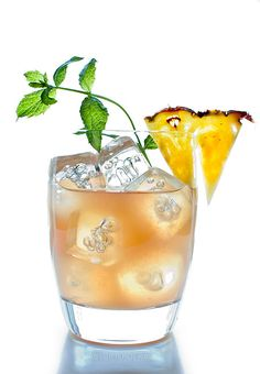 Mai Tai in glass with pineapple and mint sprig garnish