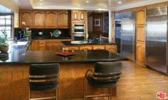 Basketball CourtChef's Kitchen with Island (Veg Sink)SubZero and Kitchen Aid Appliances100 Gallon Water HeaterSecurity CamerasOffice with Separate EntranceSurrounded by Beautiful Trees.