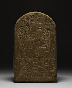 Round-topped quartzite stela of Amenmosi; at the top is a representation of Thutmose IV offering to Amun-Ra; below is a representation of the deceased kneeling and five columns of Hieroglyphic text.