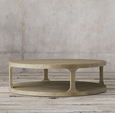 RH's Martens Round Coffee Table:Inspired by antique furnishings from the 18th century, our table has a planked top and base set edge-to-edge on the rounded frame. Skilled artisans use a proprietary, multistep process to achieve the beautifully weathered finish that highlights its smooth, curved lines.