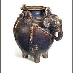 A brown glazed earthenware elephant vessel  Cambodia, 12th-13th century
