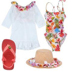 Un outfit ideale per una giornata in spiaggia. Il tutto è composto da un costume intero a fantasia floreale abbinato ad un bellissimo vestito bianco in cotone con fiori applicati, cappello 100% paglia e infradito in gomma.