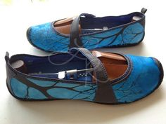 hand painted kigo footwear shoes with branches and sky showing threw