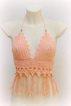 Flirty light salmon halter top for hot summer 2015. Decorated with beautiful wooden beads and fringe, for bright and carefree girls. Top is made of light salmon color of cotton yarn, but you can order it in any other color. * Shipped priority and number tracking * Adjustable string * SexyCrochet unique design * Any color * Hand wash