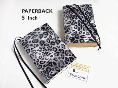 """New PAPERBACK Sizes for Stretch Book Covers in this LEOPARD Fabric at SEWING the ABCs. . . $8 . . . """"Not everyone needs to see what I'm reading . . . And the attached bookmarks are really nice too."""" TRINA BEALL. SEWING the ABCs Etsy Shop Owner. More fabrics and 2 sizes."""