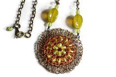 Hand Crochet Wire Circle Sun Czech Glass Necklace by PrayerMonkey. $22.00, via Etsy.