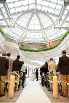 An awesome ceremony at the Winter Garden Atrium. One of our favorite Corinthian Couples!
