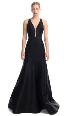 This is so deeply, utterly my style that it boggles my mind that I can't have it right now.     Deep V Halter Gown by J. Mendel