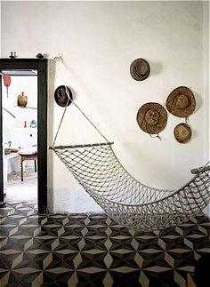 Tiles, hammock & straw hats...