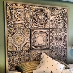 I like how they us d different tiles instead of just the same one. Pressed tin ceiling panel headboard #fauxfinish #headboard #ceilingtin