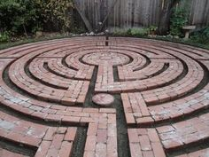 Brick labyrinth ~ This contemporary design melds together the seven circuits of the classical labyrinth and the quarter and half turns of the ancient medieval labyrinths