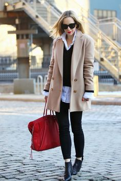 Brooklyn Blonde wearing a winter-friendly look: camel coat + layered shirt and red lips
