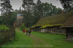 Old log houses and wooden church - Open air museum in Podkarpacie Province in Poland. www.simplycarpathians.com