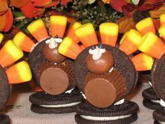 Thanksgiving-Food ideas-Turkey made with white frosting, Oreos, peanut butter cups, Malted milk balls, candy corn, mini chocolate chips, and tic tac.