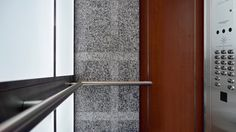 This tubular stainless steel handrail is cut, formed and finished to wrap around the lightweight interior granite columns of this custom designed elevator interior by Premier Elevator Inc.