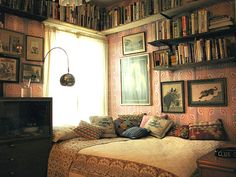 Layers of mismatched pillows and unorganized vintage books I think are less intimidating as a guest than a stark white room with white linens. This is a guest room done by Wary Meyers in Portland, Maine.