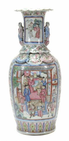 A large famille rose baluster vase, 19th century with foliate rim, richly decorated with panels of figures within garden settings, amidst intricate floral sprays, the applied handles moulded as two figures, 64cm high