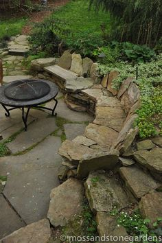 This rustic #stone bench built into the hillside is the perfect spot for sitting around the fire with family | Moss and Stone Gardens #stoneseating