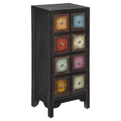 Distressed four-drawer wood chest with a multi-color block-front design.   Product: ChestConstruction Material: