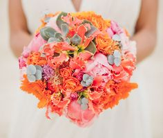 orange, coral + pink with a touch of succulents in this vibrant bouquet