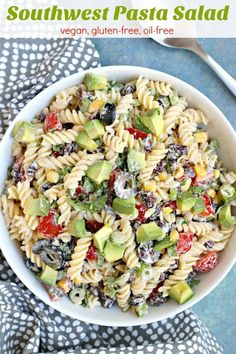 Southwest Pasta Salad with Chipotle Ranch is easy to make and loaded with flavor. Black beans, corn, tomatoes, and other vegetables combine with rotini noodles and a spicy cashew-based dressing. It's vegan, gluten-free, and oil-free. #pastasalad #southwestern #chipotle #ranch #vegan #vegetarian #glutenfree #oilfree #blackbeans #corn #olives #tomatoes #avocado #pasta