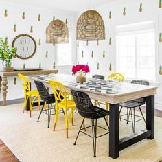Pineapple Wallpaper, Yellow-and-Black Chairs Make This a Dining Room for Fun >> http://www.hgtv.com/design-blog/design/non-pastel-colors-to-decorate-with-this-spring?soc=pinterest