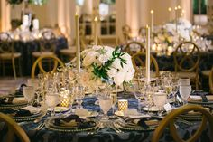 See more of Allie Williams and Matt Slocum's Catholic wedding ceremony and ballroom reception with a blue and gold color palette in Washington, DC! Wedding Reception Decorations, Wedding Table, Reception Ideas, Navy Blue And Gold Wedding, Vintage Wedding Colors, Floral Event Design, Ballroom Wedding, Taper Candles, Traditional