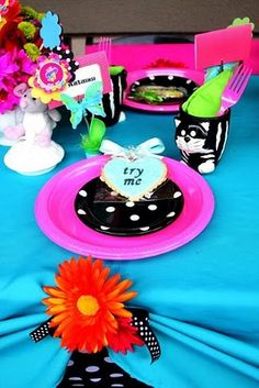 Alice in Wonderland party. Not the theme but love the polka dot on vivid colors scheme for K's party.