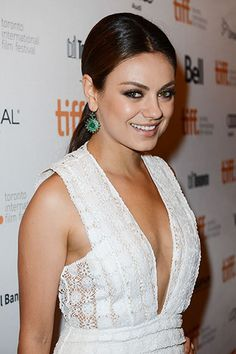 The 10 Chicest Ponytails for Fall 2013  -  Mila Kunis: Centerpart and Low