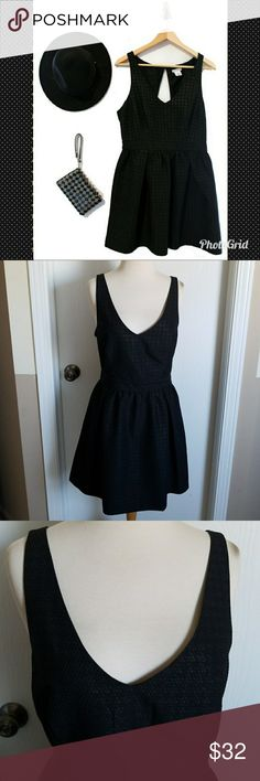 COOPERATIVE FIT AND FLARE DRESS Cooperative by Urban Outfitters fit and flare dress sz 12. Dress worn once, in amazing condition!! Black dress with hints of gold, v-neck front with partial open back, side zipper closure, has 1 button closure at the back of the neck. This is a must have dress!! Urban Outfitters Dresses Midi
