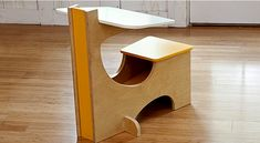 A cool & compact desk for kids without bulky retangular edges that can obstruct small offices. It's complete with some storage underneath too. Check out the link for instructions by Lowe's on how to make it yourself.
