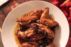 These wings were marinated in this sweet-and-spicy sauce that was later boiled down to make a delectable glaze for the crispy, tender wings. You can marinate them anywhere from 2 hours to a day, or just bake them with olive oil and make the glaze to finish.Click here to see The Ultimate Wing Party story.