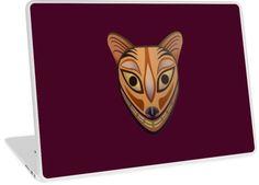 Laptop skin of tribal feline mask in Redbubble!