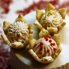 Snowflake Cups with Pomegranate Mousse-- hmm what else could you fill them with...