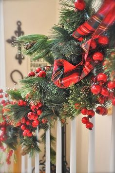 I decorate my foyer banister every Christmas with greenery and red berries and ribbon with lots of red each year.  This one is great.