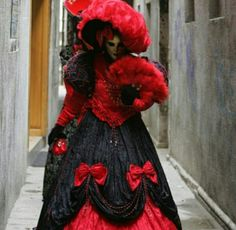 Lady In White Face Mask Wearing Gorgeous Long Red & Black Dress
