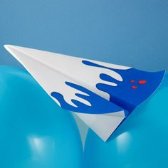 Craft project: Make a paper airplane glider that floats through the air and can be thrown hard or soft. This   paper airplane glides on a long and steady path, and can also do stunts. Printable patterns included.