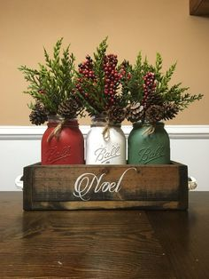 Mason Jar Chirstmas centerpiece mason jar christmas noel This is a perfect way to ring in the holiday season with this rustic Christmas centerpiece. Christmas Jars, Winter Christmas, Christmas Home, Christmas Colors, Simple Christmas, Christmas Center Piece Ideas, Apartment Christmas, Christmas 2019, Christmas Island