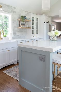 Modern kitchen remodel before and after inspiration. White kitchen with blue gray island, wood tones and touches of gold Off White Kitchens, Modern Farmhouse Kitchens, Country Kitchens, Blue Kitchen Island, Gray Island, Kitchen Ideas, Kitchen Decor, Kitchen Updates, Country Kitchen Inspiration