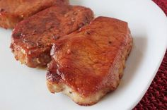 "Honey Garlic Baked Pork Chops       4 1"" thick boneless pork chops  salt and pepper to taste   3 tbs olive oil   1/4 cup honey   2 tbs..."